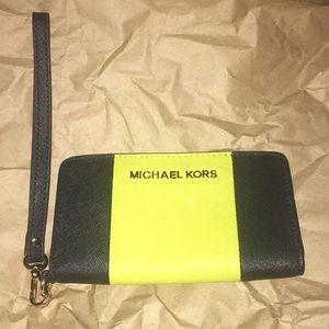 Brand new! Michael Kors wristlet.